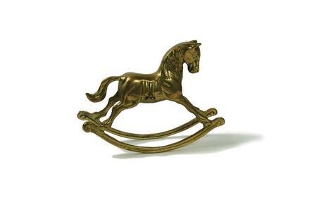 Brass rocking horse represent childhood