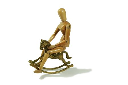 relive: Brass rocking horse represent childhood, Wooden model representing a person Stock Photo