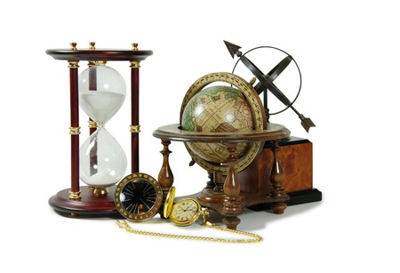 Hour glass used to measure time, Antique time zone converter used by travellers, Gold pocket watch with a metal chain, Old world globe with basic navigation notations, Sundial telling the number of hours to go or the years left