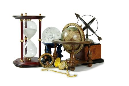 Hour glass, Crystal ball, Antique time zone converter used by travellers, Gold pocket watch, Old world globe with basic navigation notations, Sundial
