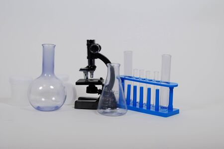 Test tubes and beakers for laboratory experiments, Small Microscope used in scientific research Stock Photo - 3953907