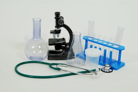 Test tubes and beakers for laboratory experiments, with  Small Microscope used in scientific research and Medical stethoscope used to listen to heart beats