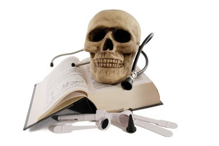 labratory: Medical book and a skull model for studying medicine