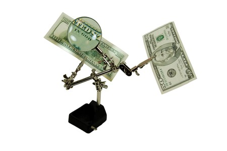 moola: Clamp holder used to position items when working on them with a magnifying glass with money magnifying in God