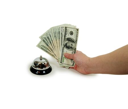 moola: Ring bell for service usually placed on a desk with Money in hand in the form of many large bills
