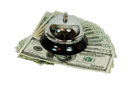 moola: Ring bell for service usually placed on a desk, and Money in the form of many large bills Stock Photo