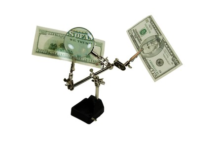 moola: Clamp holder used to position items when working on them with a magnifying glass showing we trust in money  Stock Photo