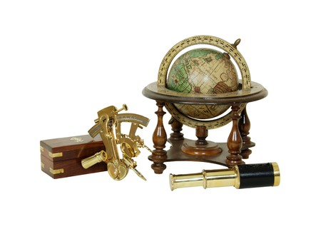 Brass Sextant used for navigating by the stars, telescoping telescope used to see distances, Old world globe with basic navigation notations Stockfoto