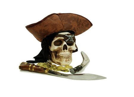 booty pirate: Pirate Skull with eye sockets and teeth with gold and other booty, Large hunting knife made of metal and wood, Skull with eye sockets and teeth, Closeup of a gold coin purchased as an investment