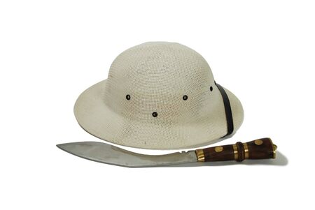 pith: Pith helmet worn during explorations to protect the head from sun stroke, large hunting knife Stock Photo