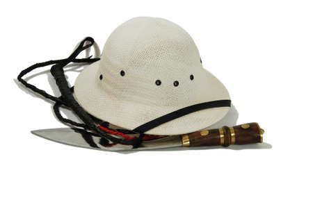 Large hunting knife made of metal and wood, Whip of many tails made of leather and brads, Pith helmet worn during explorations to protect the head from sun stroke Stock Photo - 3954393