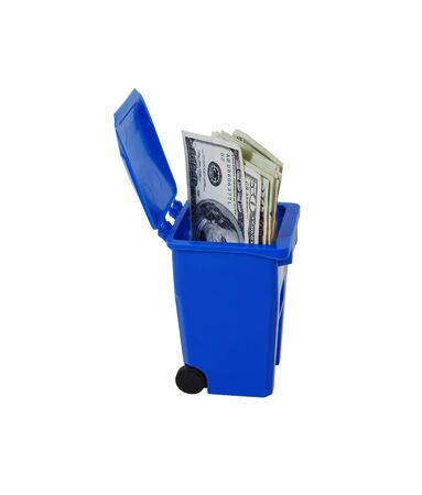 going green: Recycling bin used to collect items to be reused, Going green to help preserve our natural resources, Money in the form of many large bills