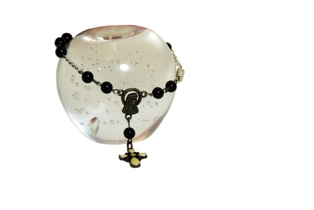 catholism: Glass apple with bubbles in the interior with Rosary beads used for prayer in the Cathoic faith