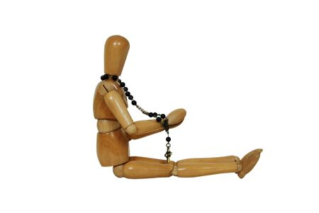 catholism: Rosary beads used for prayer in the Cathoic faith, Wooden model representing a person