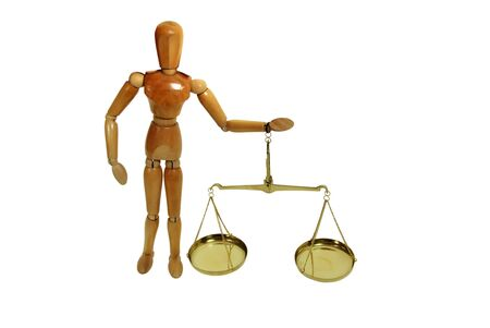 Brass and wood Scale used to weigh out small items held by wooden model representing a person Stock Photo - 3953688