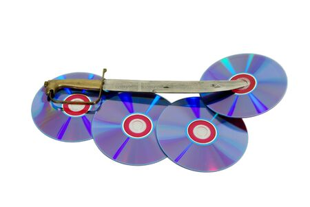 Dagger made of metal inserted into a couple of purple dvds with red interiors