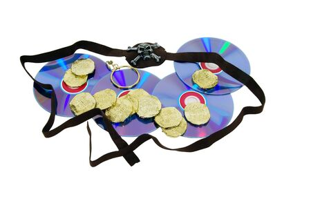 A couple of purple dvds with red interiors, gold coins, earring and eye patch  Closeup of a gold coin purchased as an investment