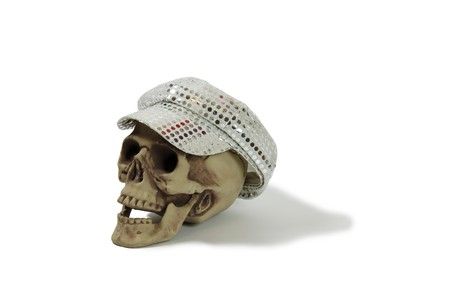 reflect: Cap with brim with sparkle dots that reflect on Skull with eye sockets and teeth Stock Photo