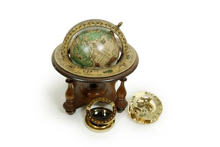 ancient pass: Sundial telling the number of hours to go or the years left, Antique time zone converter used by travellers, Old world globe with basic navigation notations Stock Photo
