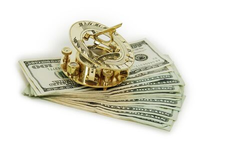 moola: Sundial telling the time with Money in the form of many large bills