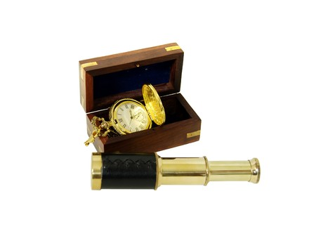 inlays: Wooden box with brass corner inlays, Gold pocket watch with a metal chain, Telescoping telescope used to see distances
