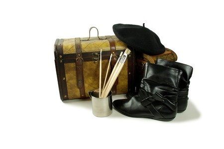 Stainless steel cup for drinking or holding items, Paint brushes used for many different mediums, A pair of old cases for storing items, Black Beret that wears tight to the head, Black leather boots to be worn on the feet