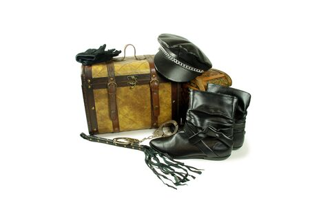 old items: A pair of old cases for storing items, Leather biker cap with a chain across the bill, Whip made of woven leather, White gloves with textured bumps for gripping, Black leather boots to be worn on the feet