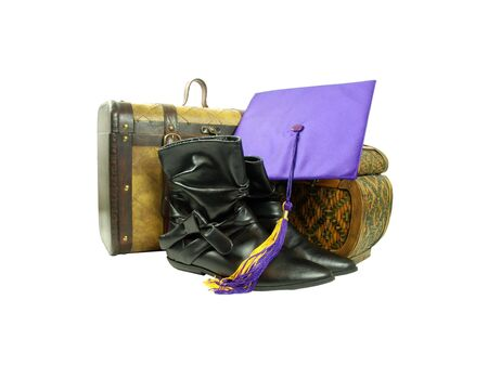 Black leather boots to be worn on the feet, A pair of old cases for storing items, Graduation mortar board with tassle used during ceremonies photo