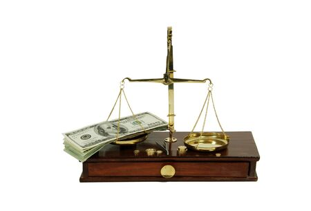 moola: Brass and wood Scale used to weigh out small items and Money in the form of many large bills Stock Photo