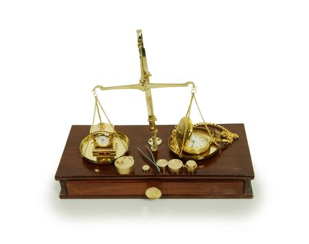 Brass and wood Scale used to weigh out small items, Gold pocket watch with a metal chain, small formal clock photo