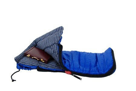 Sleeping bag used to keep warm on camping trips, Burgandy leather Briefcase used to carry items to the office photo