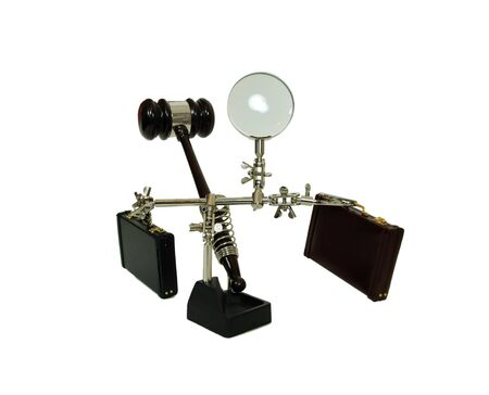 Magnifying holding tool used to position items to be worked on, leather briefcases used to carry items to the office, a ceremonial wooden gavel photo