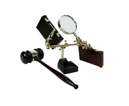 Magnifying holding tool used to position items to be worked on, leather briefcase used to carry items to the office, a ceremonial wooden gavel photo