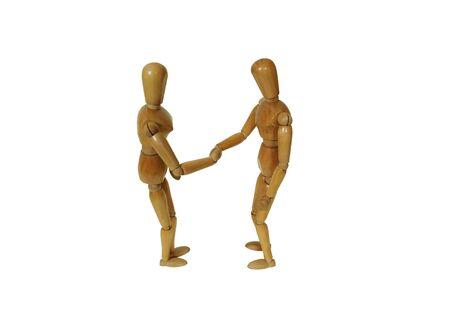 grasp: Wooden model representing a person shaking hands together