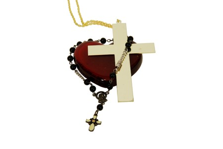 catholism: Red glass heart symbolizing love and romsnvr Rosary beads used for prayer in the Catholic faith