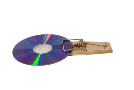 Purple DVD disk caught in a mouse trap used to catch small rodents Stock Photo