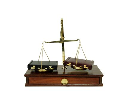 personal decisions: Leather briefcases used to carry items to the office, brass and wood Scale used to weigh small items