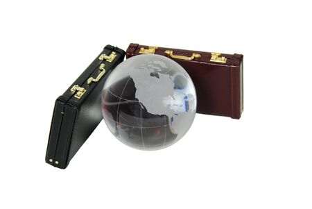 Crystal globe with navigational lines, leather briefcases used to carry items to the office Stock Photo - 4026258