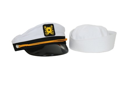 White Nautical hat with black brim and yellow braids and sailor cap Stock Photo