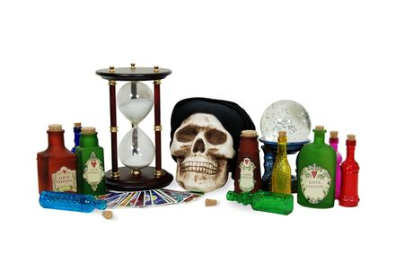 foresee: Fortune telling cards used by Gypsies, bright colorful bottles, Skull, Crystal ball for seeing into the future, hour glass used to measure time Stock Photo