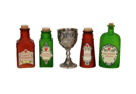 potion: Silver antique chalice with grapes and leaves embossed on the sides and bright colorful love potions Stock Photo
