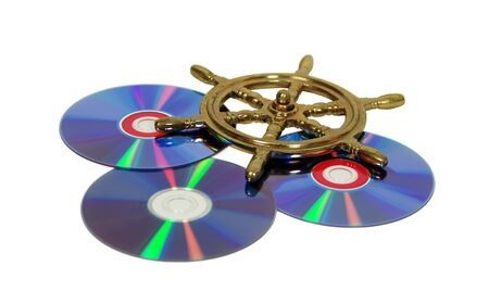 charting: A couple of purple dvds with red interiors, nautical steering wheel made of brass