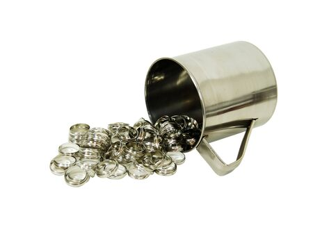 Stainless steel cup for drinking or holding items, silver rings symbolizing eternity or love photo