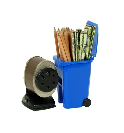old items: Recycling bin used to collect items to be reused, wooden pencils used for drawing and old school pencil sharpener