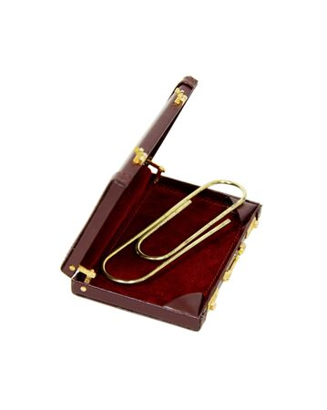 Paperclip used to hold pages or other media together in a leather briefcase used to carry items to the office photo