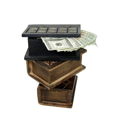 resemble: Money in the form of many large bills in large wooden block hollowed and carved to resemble a book