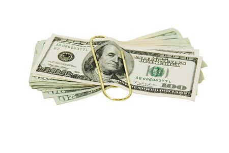 Paperclip used to hold pages or other media together such as money in the form of many large bills Stock Photo - 4179152