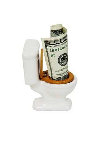 Porcelain toilet with wooden seat with money in the form of many large bills photo