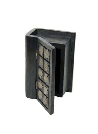 resemble: Large wooden block hollowed and carved to resemble a book opened