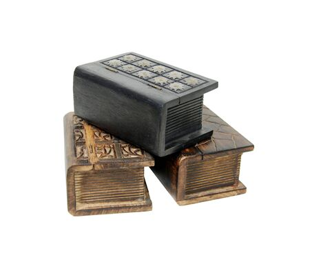 resemble: Large wooden block hollowed and carved to resemble a book